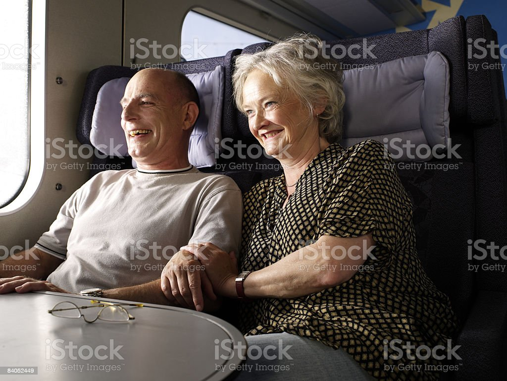 Couple on train stock photo
