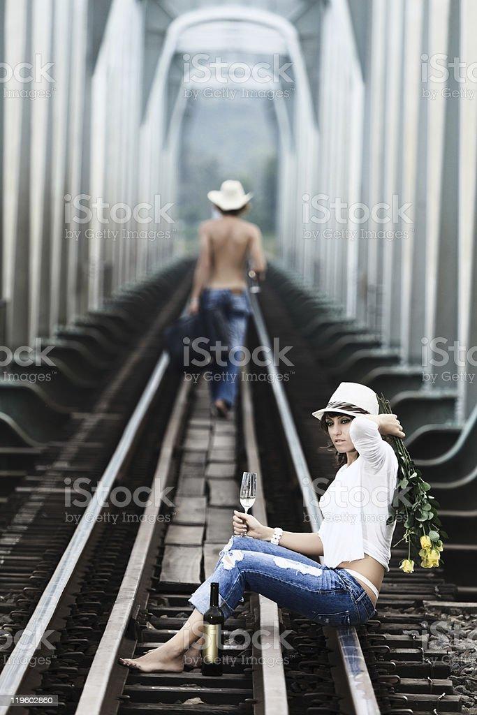 Couple on train tracks stock photo