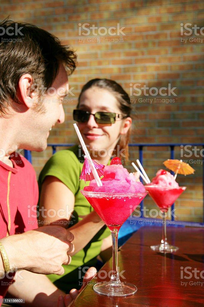 Couple on vacation having a daiquiri royalty-free stock photo