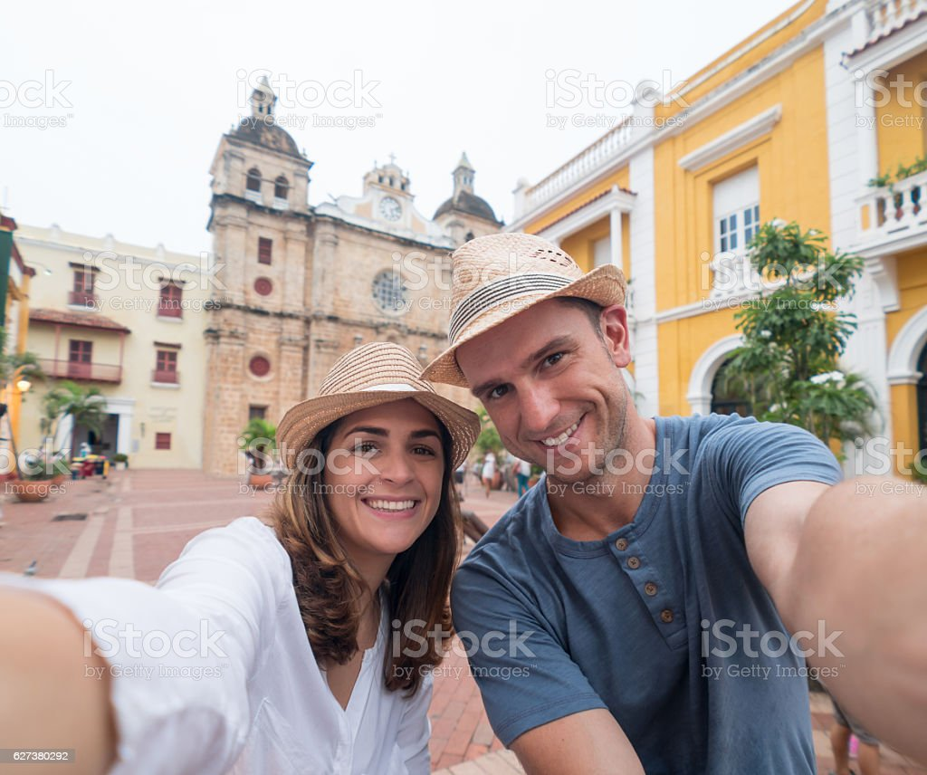 Couple on vacation taking a selfie stock photo