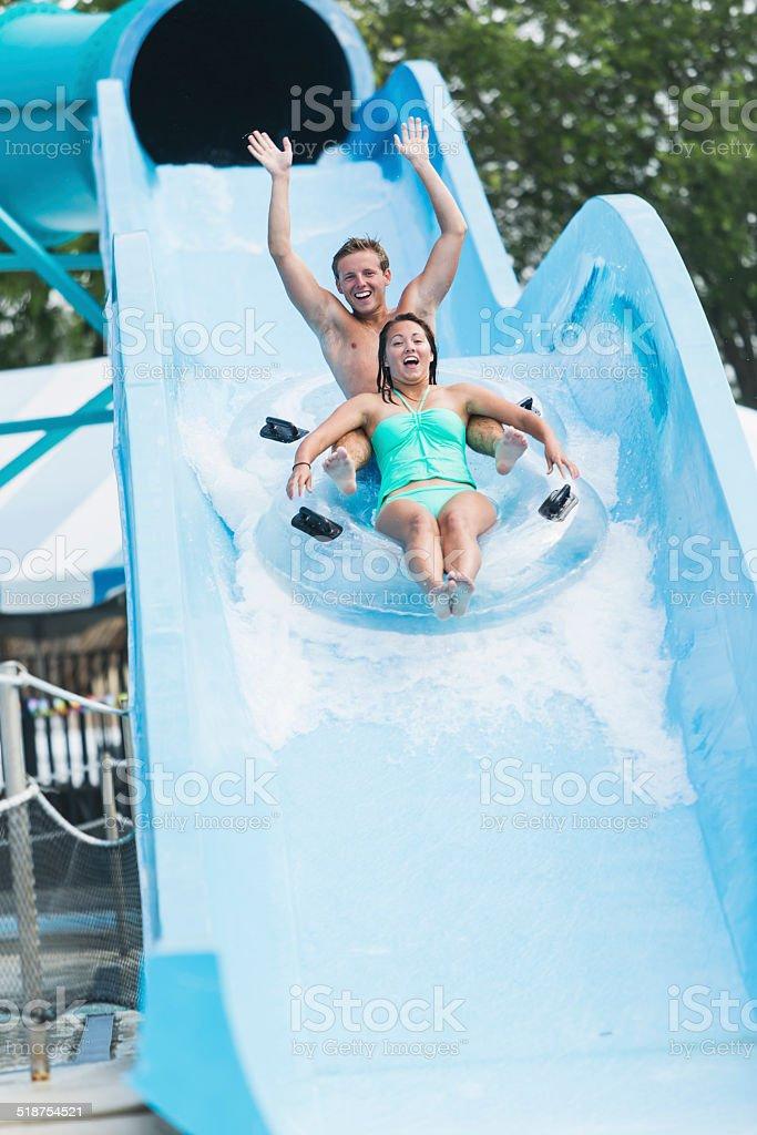 Couple on water slide stock photo