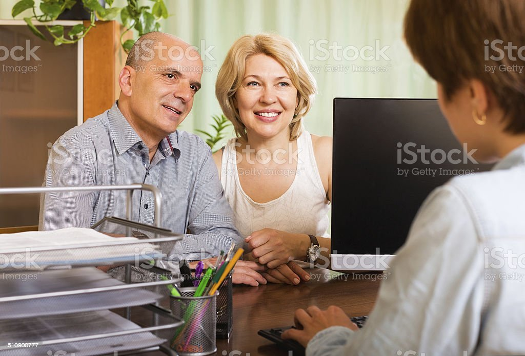 Couple opening account in bank stock photo