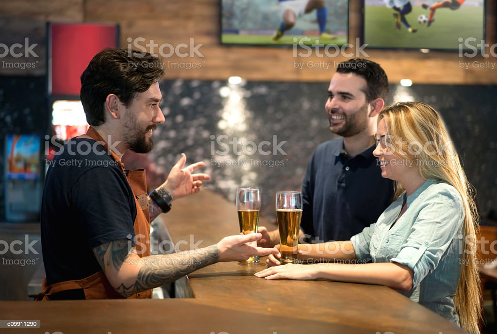 Couple ordering drinks at the bar stock photo