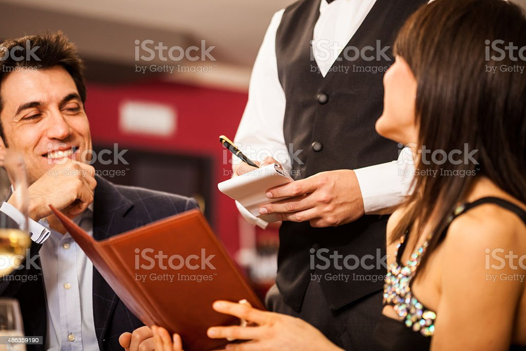 Couple ordering food stock photo