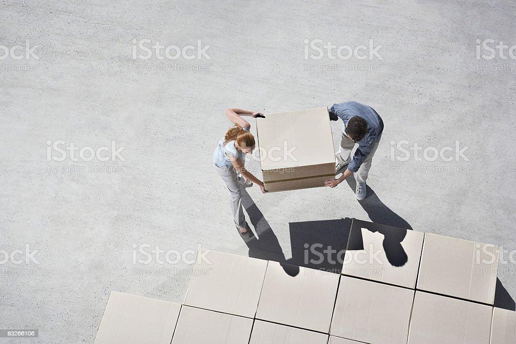 Couple organizing boxes stock photo