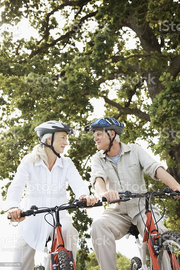 Couple out in the wood with their bicycles royalty-free stock photo