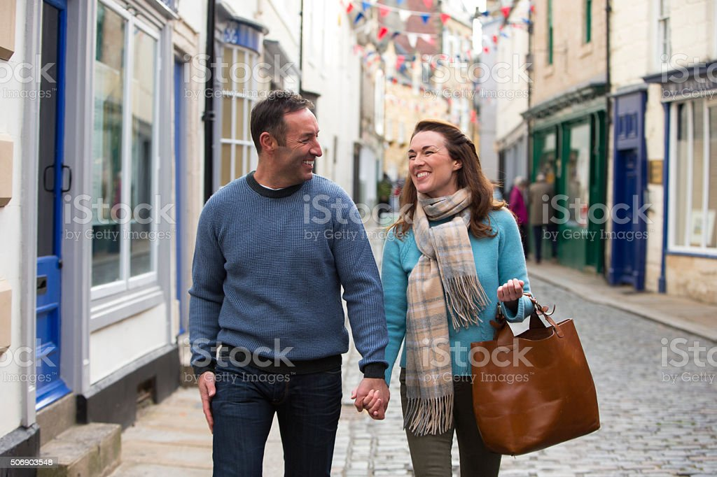 Couple Out Shopping in Town stock photo