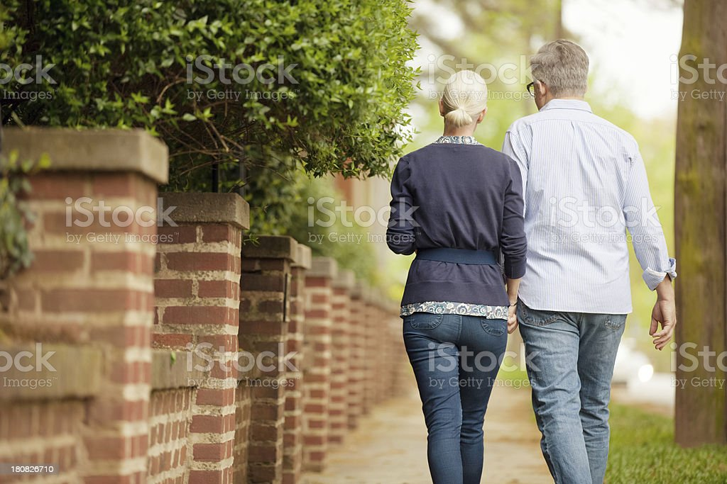 couple out walking in the neighborhood royalty-free stock photo