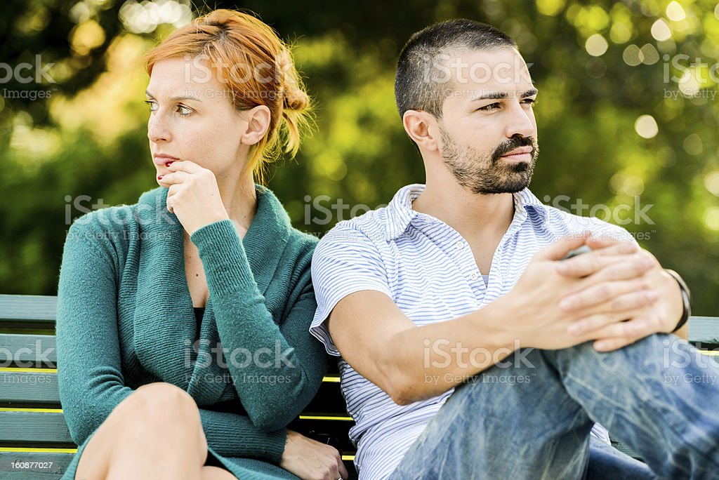 Couple outdoors having relationship troubles stock photo