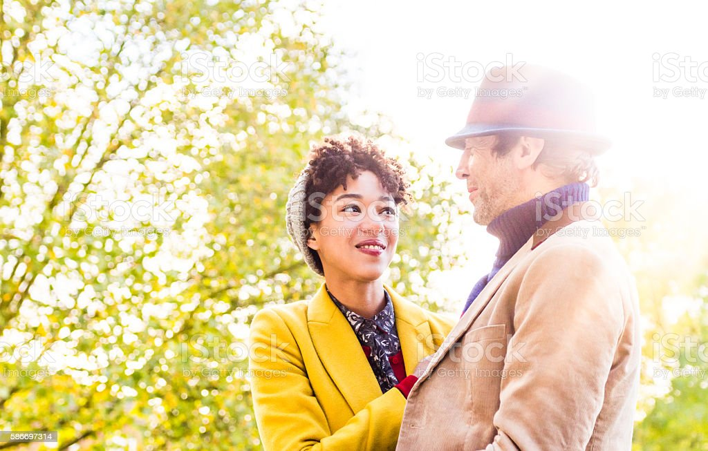 Couple outdoors in the sun in an autumn day stock photo