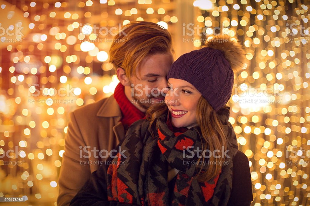 Couple outdoors in winter city. stock photo