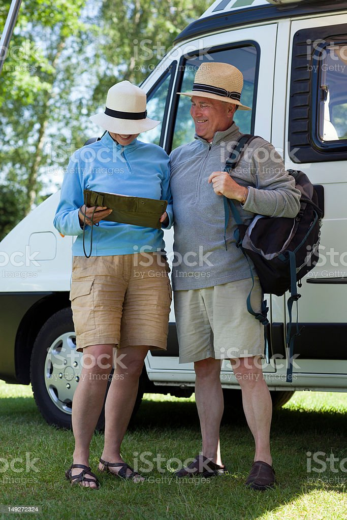 Couple outside campervan with backpack stock photo