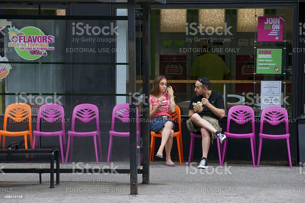 Couple outside frozen yogurt shop, Manhattan, New York City stock photo