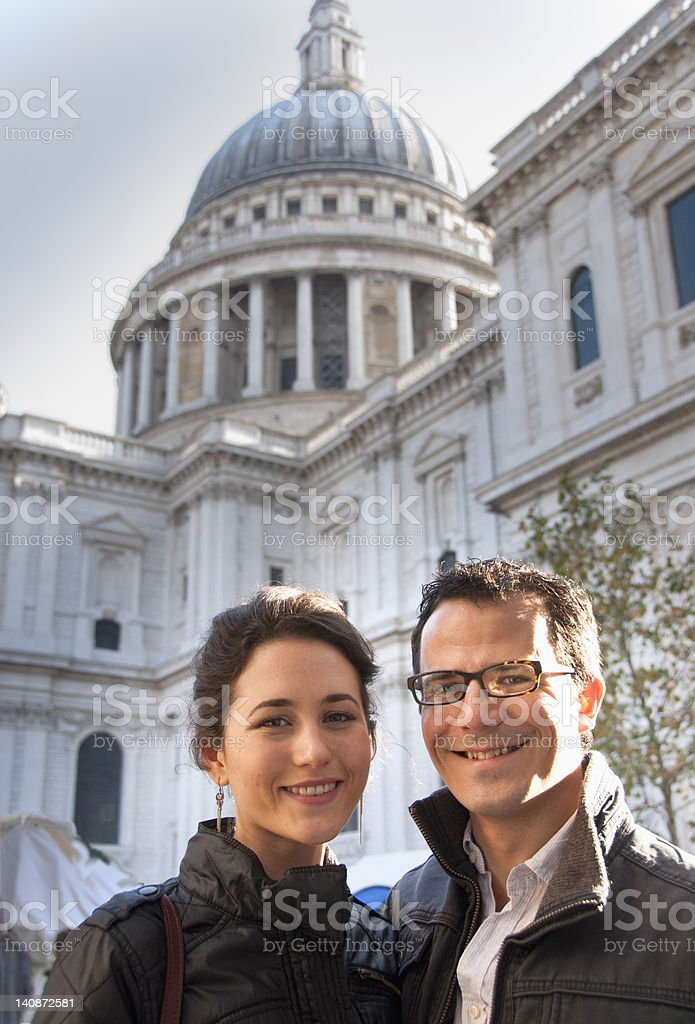 Couple outside St Pauls Cathedral stock photo