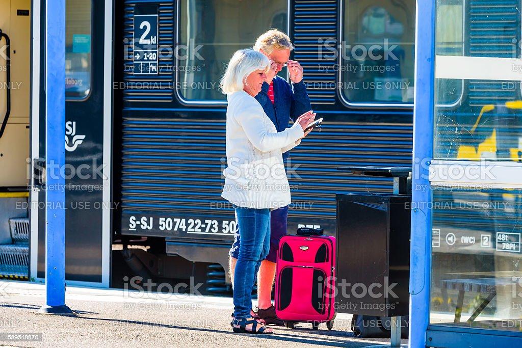 Couple outside train wagon stock photo