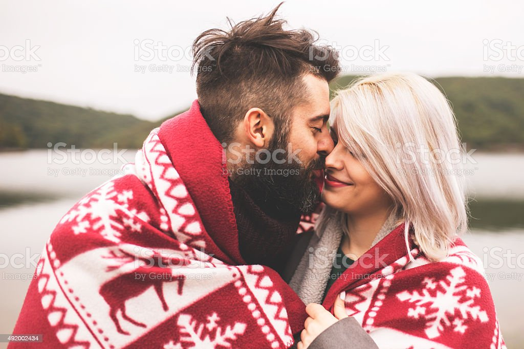 Couple outside under the blanket stock photo