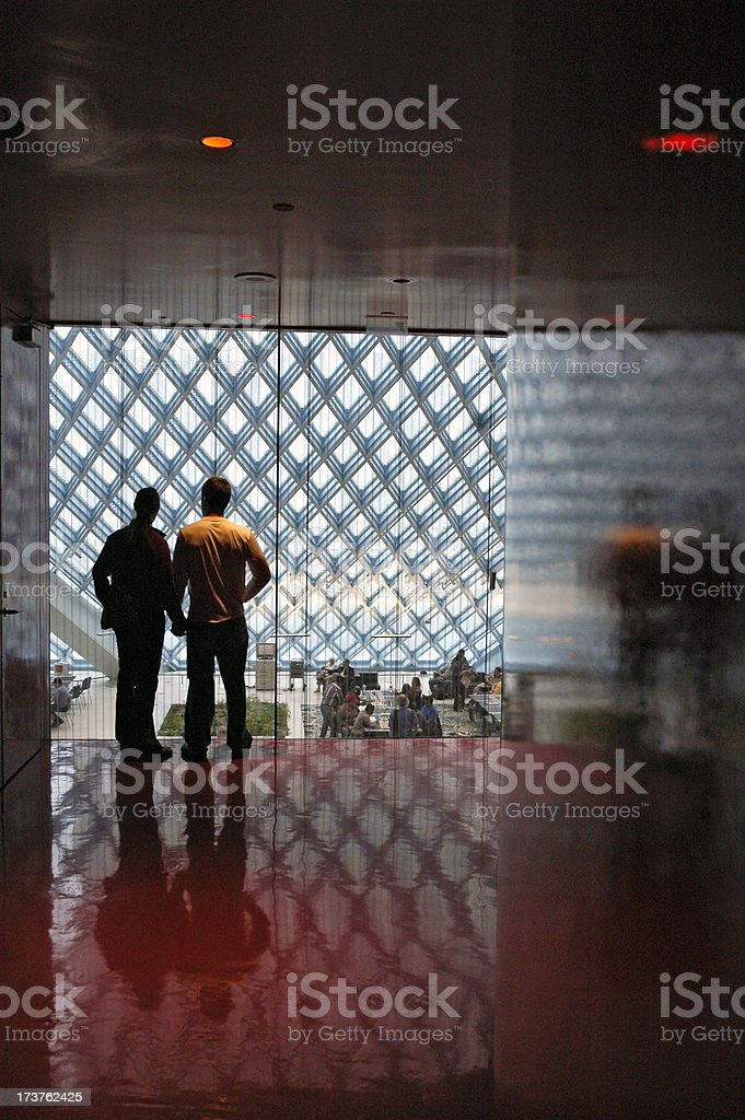 Couple overlooking the main entrance of the Seattle Public Libra stock photo