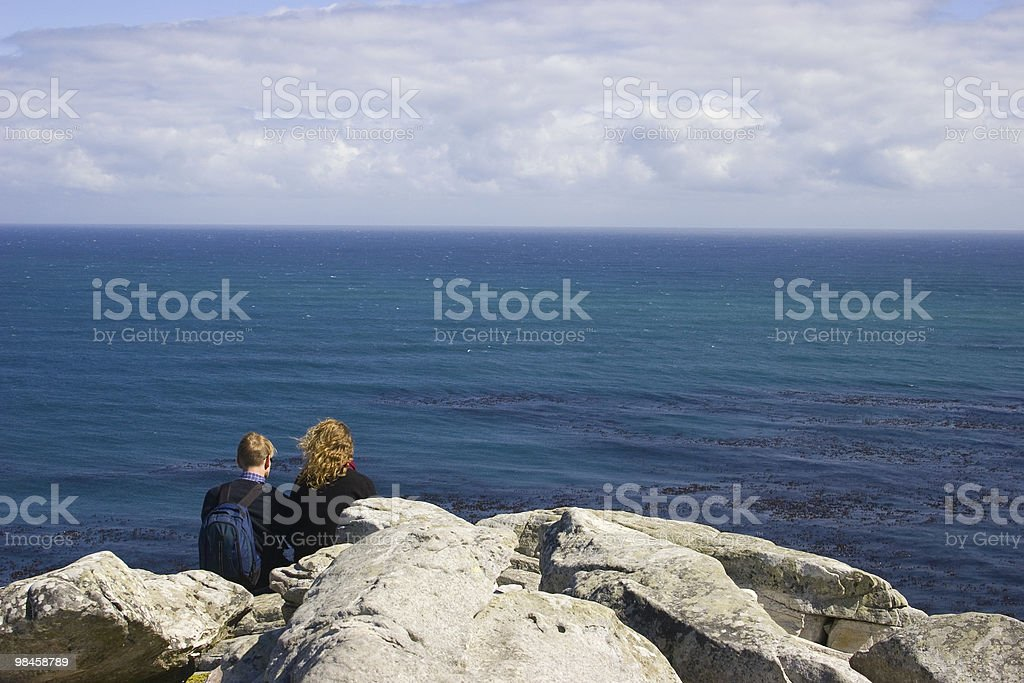 Couple overlooking the ocean royalty-free stock photo