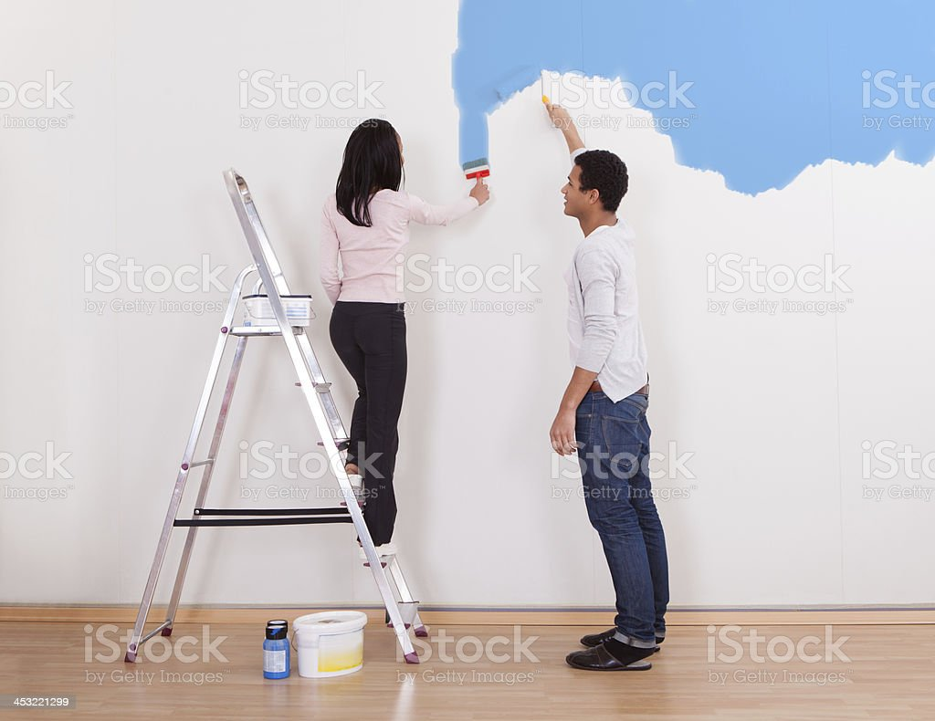 Couple Painting The Wall royalty-free stock photo