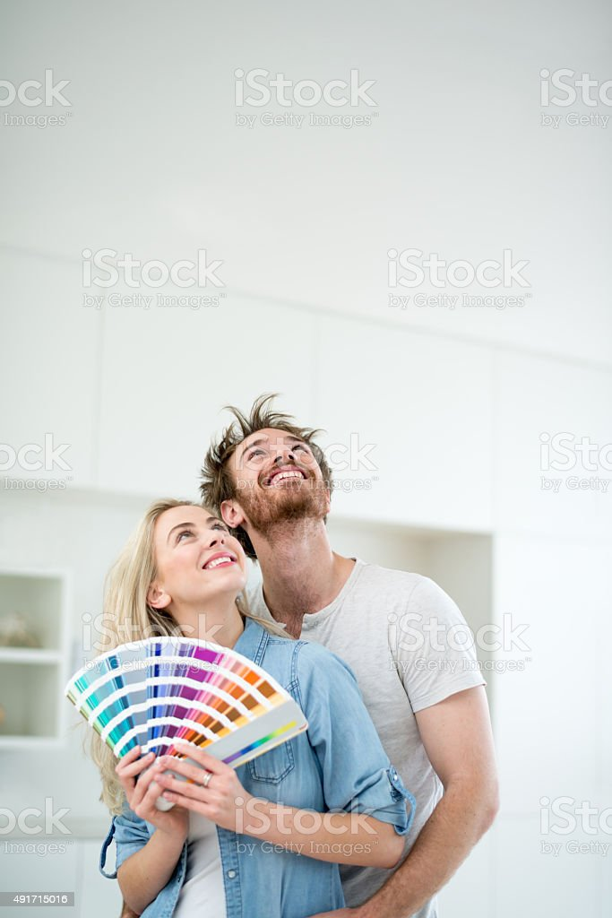 Couple painting their home stock photo