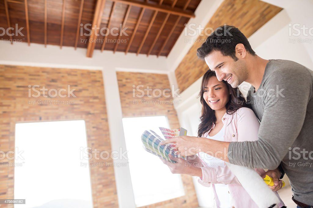 Couple painting their house stock photo