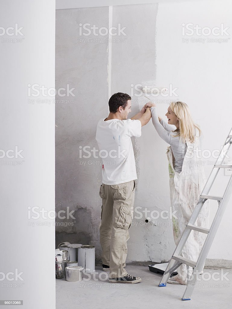 Couple painting wall royalty-free stock photo