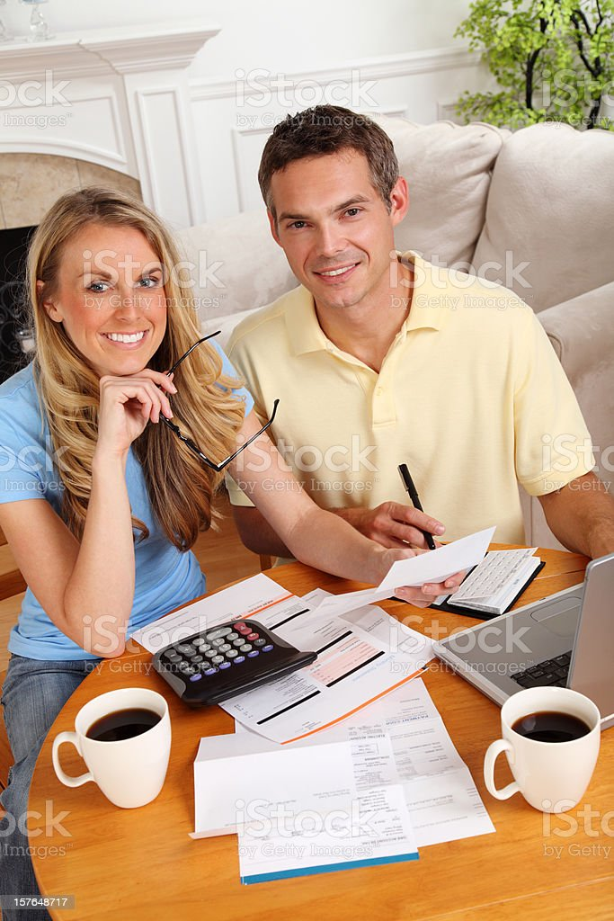 Couple Paying Bills At Home royalty-free stock photo