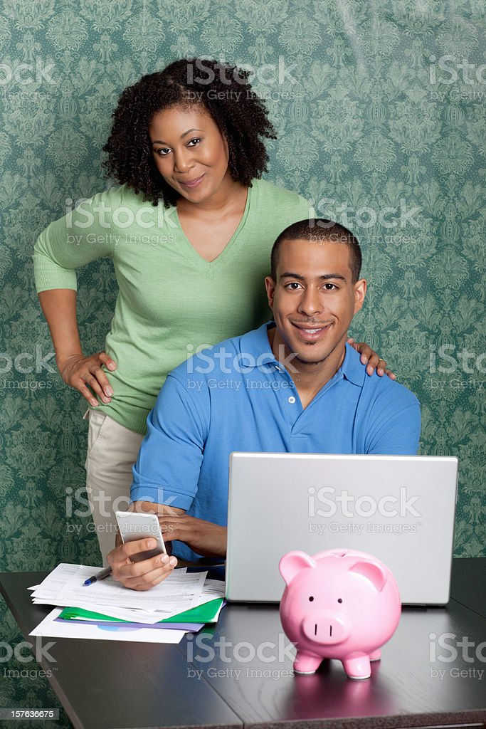 Couple paying bills by using online banking at home royalty-free stock photo