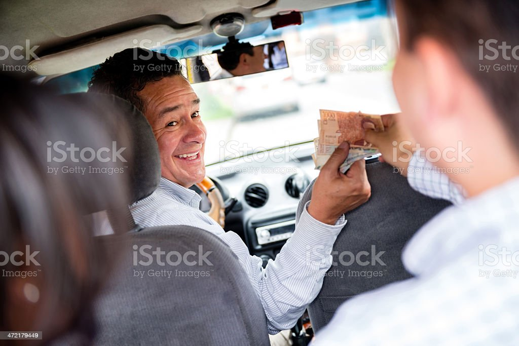 Couple paying for the taxi stock photo