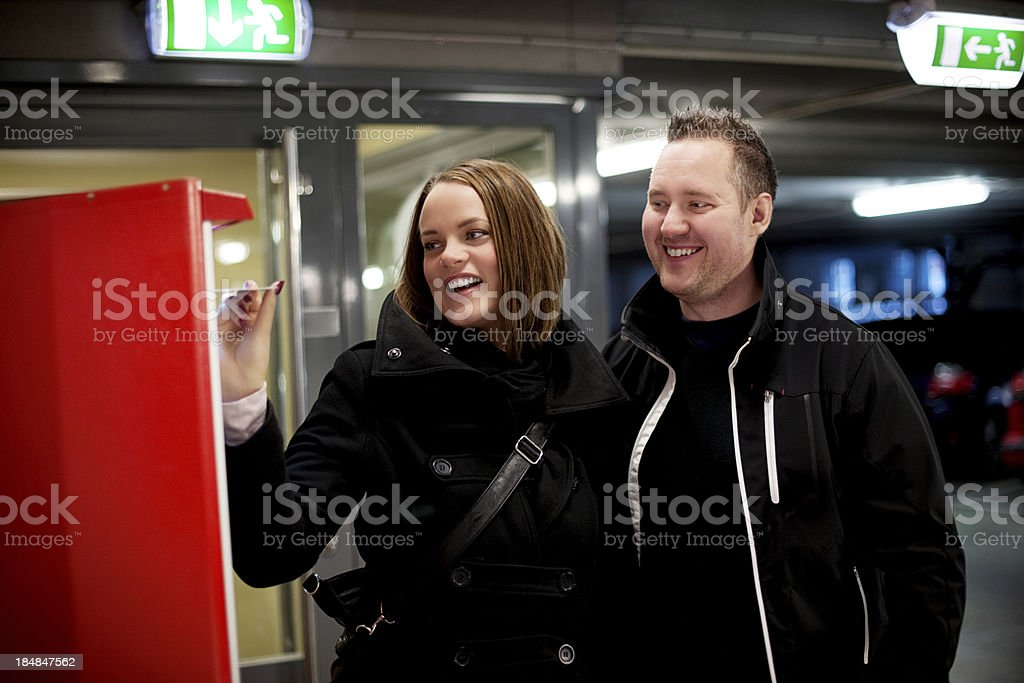 Couple paying for their parking stock photo