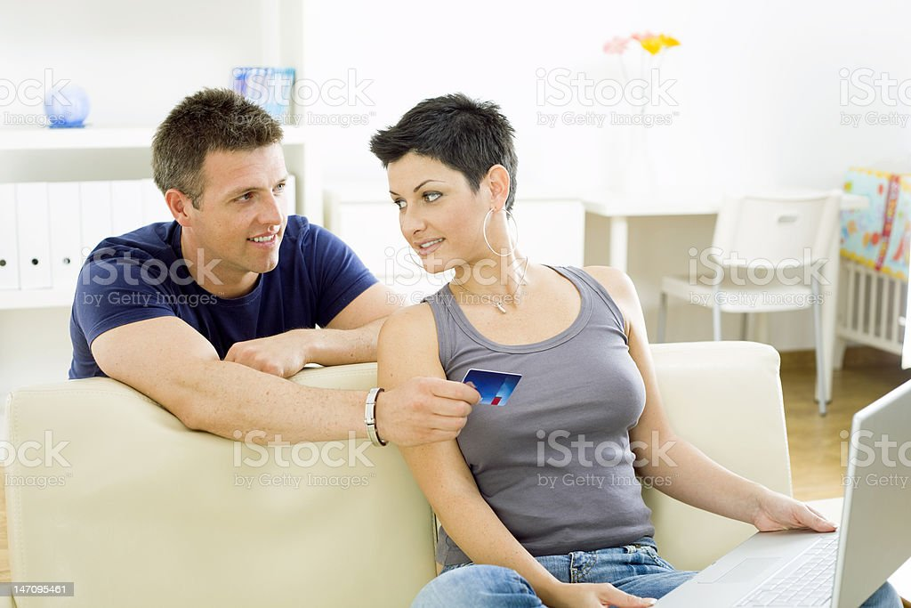 Couple paying with credit card royalty-free stock photo