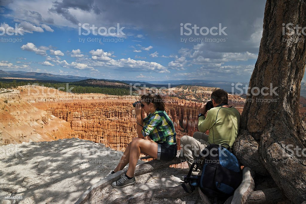 Couple Photographing, Bryce Canyon before Storm, Utah, USA stock photo