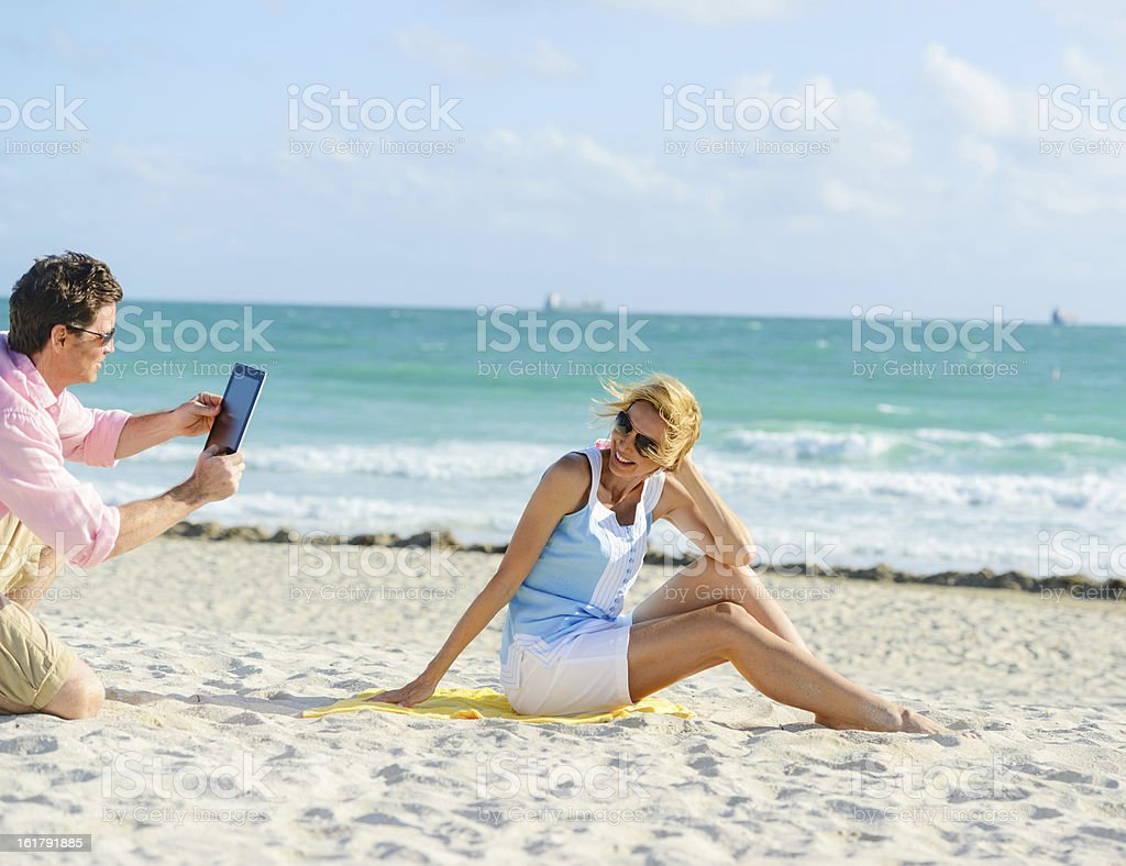 Couple Photogrpahing each other with Digital Tablet royalty-free stock photo