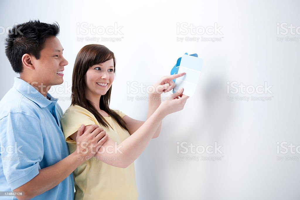 Couple picking out paint. royalty-free stock photo