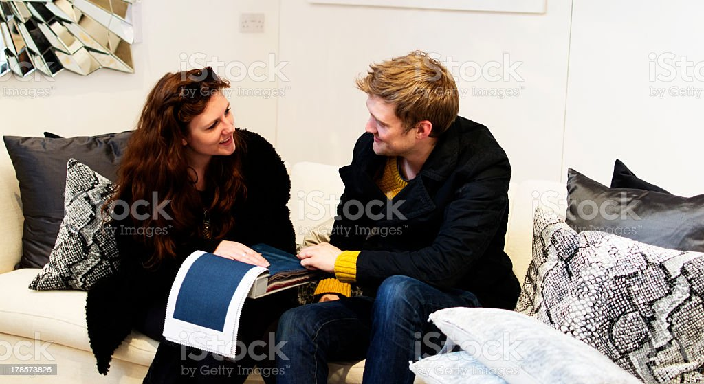 A couple picking upholstery for a new couch royalty-free stock photo