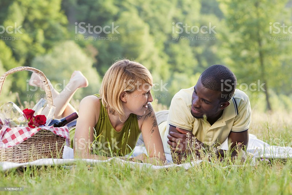 couple picnicking in park royalty-free stock photo