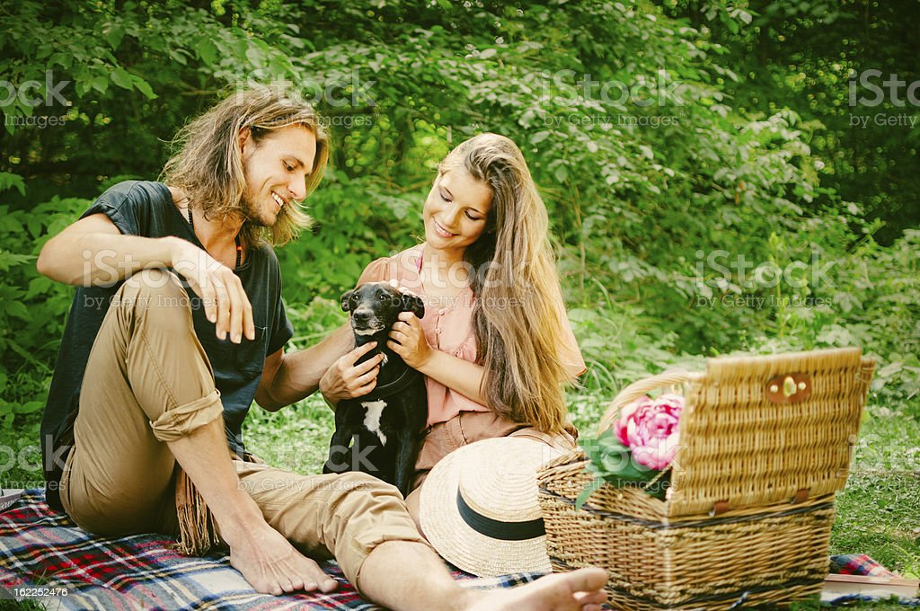 Couple picnicking in the park royalty-free stock photo