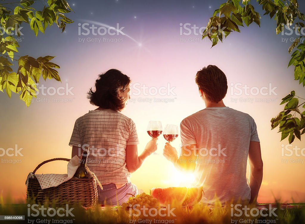 couple picnicking together stock photo