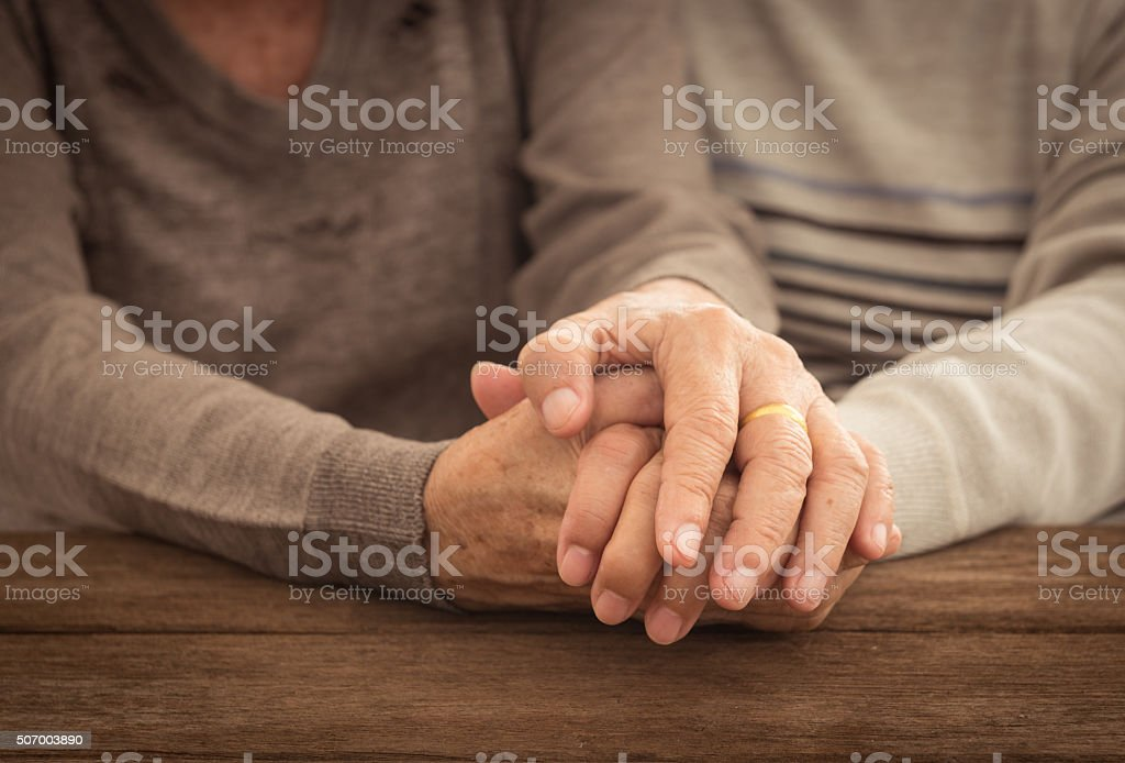 Old people holding hands. couple concept. love concept.