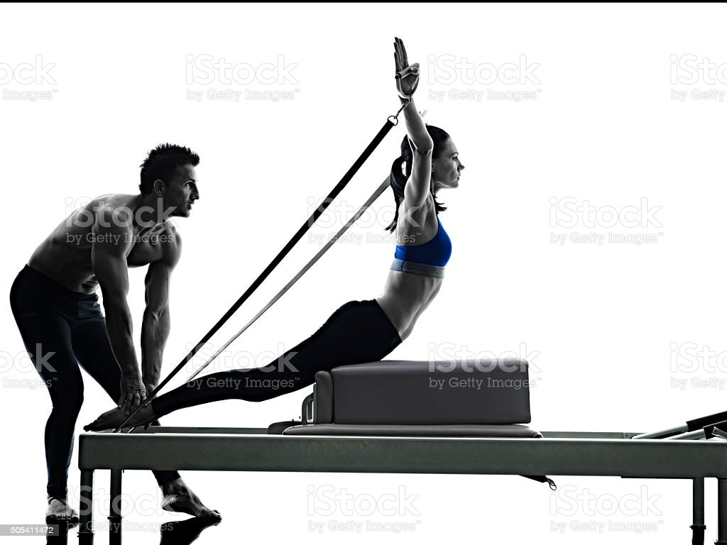 couple pilates reformer exercises fitness isolated stock photo