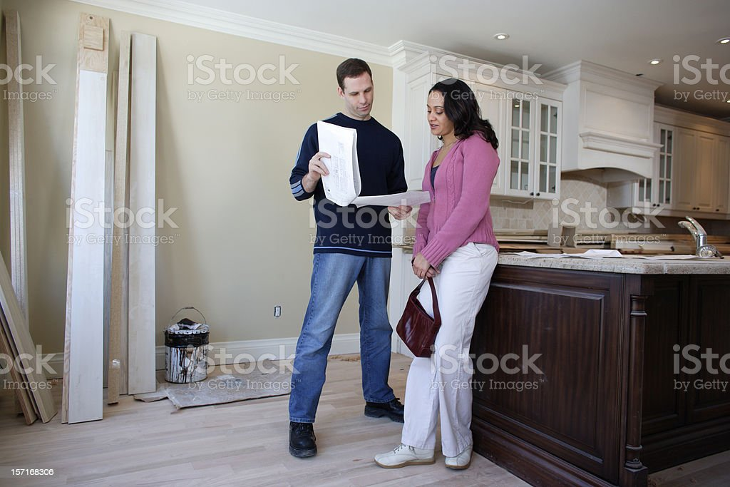 Couple planning a new kitchen royalty-free stock photo