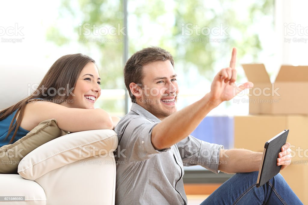 Couple planning and moving home stock photo