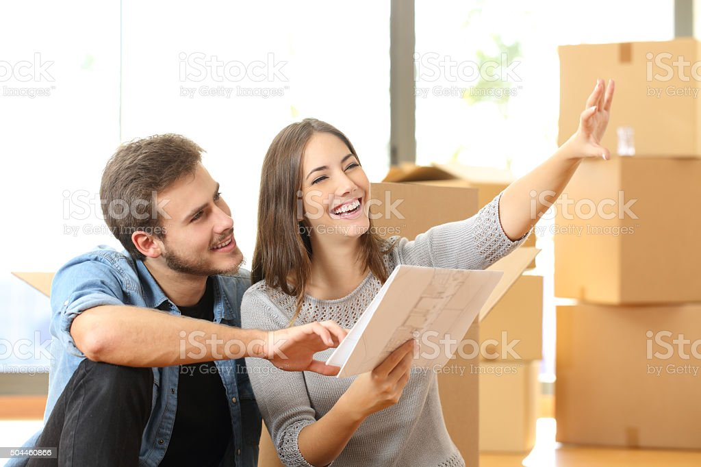 Couple planning decoration when moving home stock photo