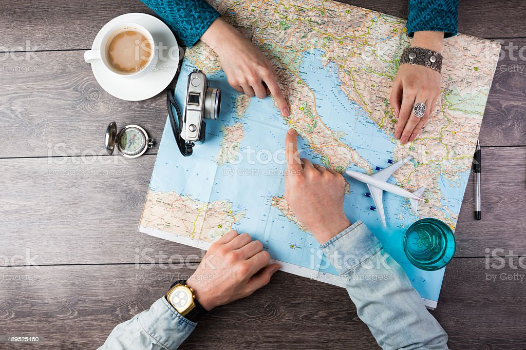 couple planning honeymoon stock photo