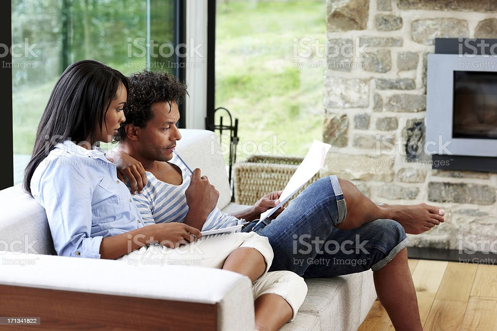 Couple planning their budget - Indoors stock photo