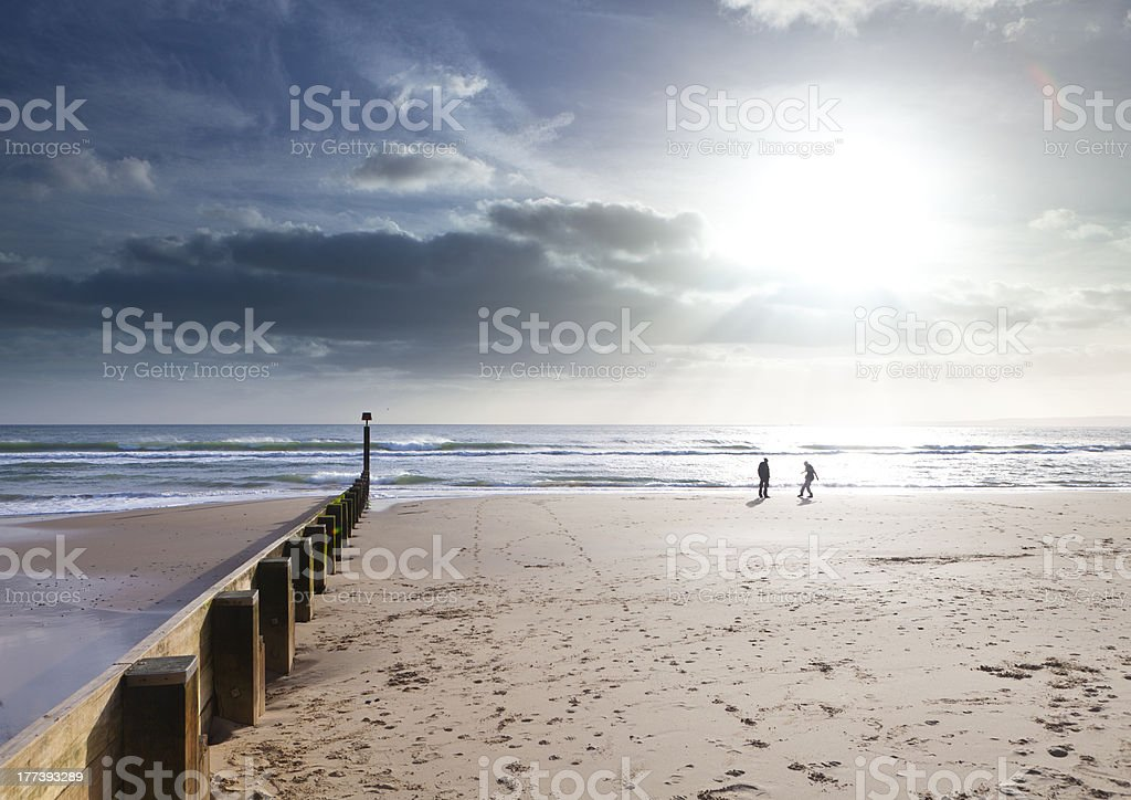 Couple play on the beach in sunset, dancing stock photo