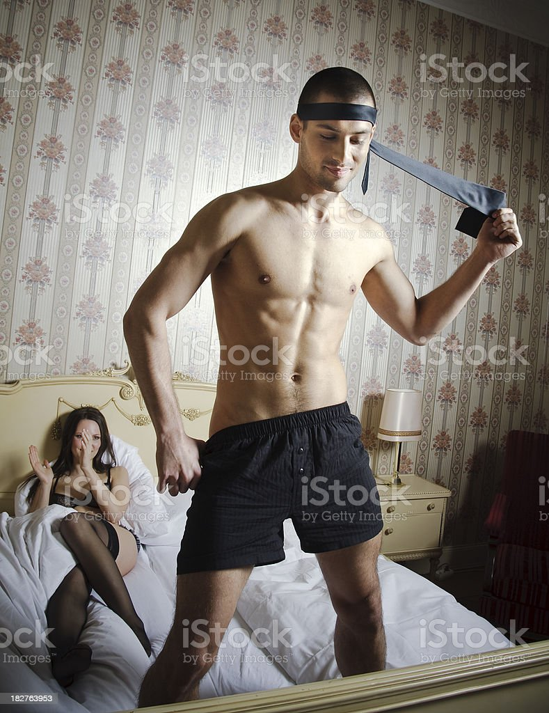 Couple playing a Couple's Game of Striptease royalty-free stock photo