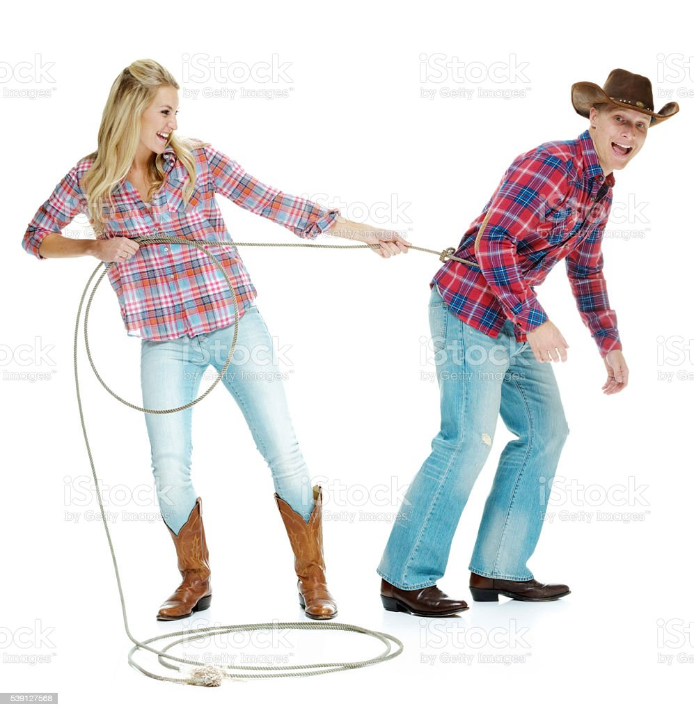 Couple playing around with a lasso stock photo