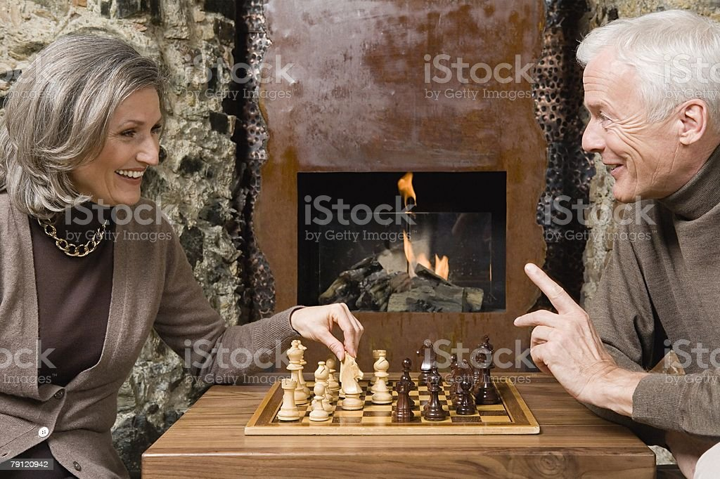 Couple playing chess royalty-free stock photo
