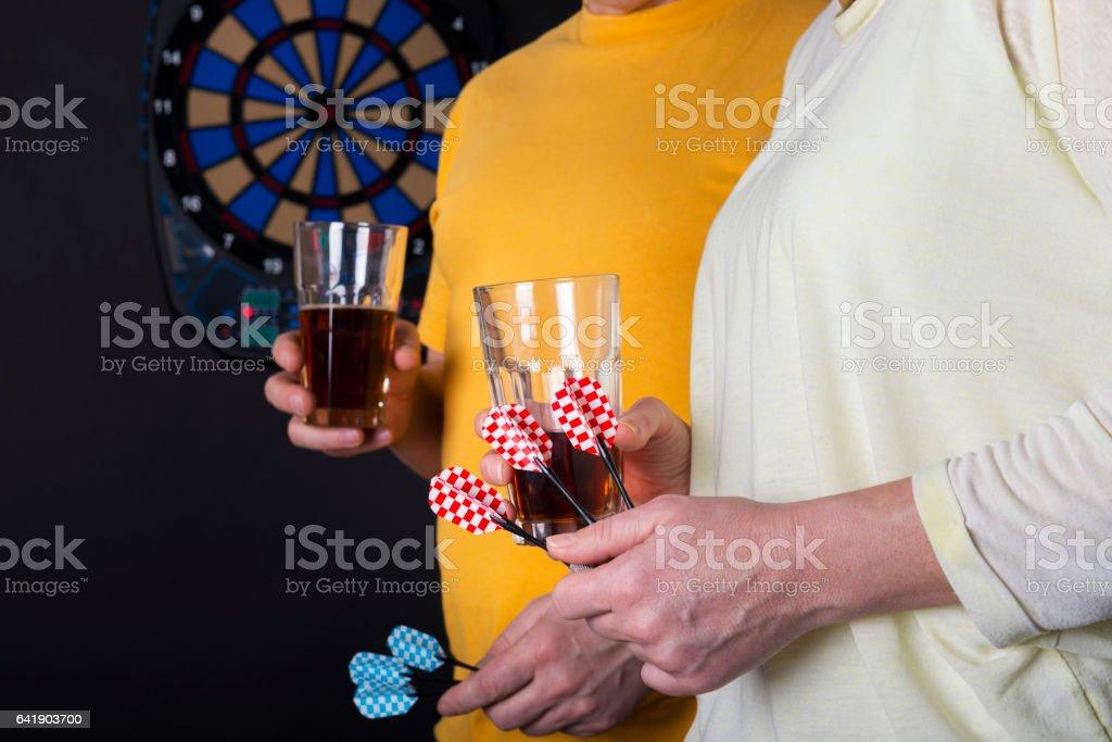 couple playing darts stock photo